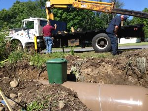 Rich Holden and Shad Wells installing an underground tank in Leominister MA